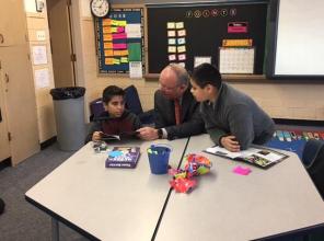 Photo of Scott Wylie reading to kids